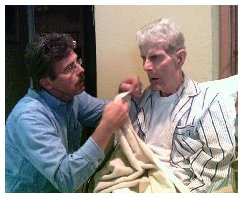 Devotion of a son to his father. My brother shaving him and the love of a father showing through.